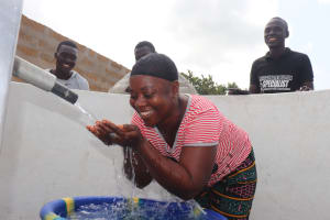 The Water Project: Kamasondo, Borope Village, Main Motor Rd. Junction -  Woman Celebrating The Well