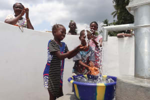 The Water Project: Kamasondo, Robombeh Village, Next to Mosque -  Kids Splash Water At The Well