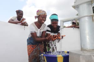 The Water Project: Kamasondo, Robombeh Village, Next to Mosque -  Splashing At The Well