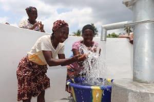 The Water Project: Kamasondo, Robombeh Village, Next to Mosque -  Splashing Well Water