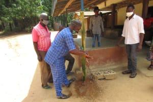 The Water Project: Kamasondo, Robombeh Village, Next to Mosque -  Village Headman Demonstrating Handwashing