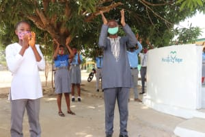 The Water Project: Kankalay Primary and Secondary School -  Principal Joins Students In Celebrating The Well