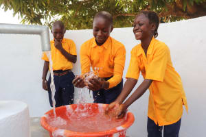 The Water Project: Kankalay Primary and Secondary School -  Students Splashing At The Well