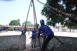 The Water Project: Kankalay Primary and Secondary School -  Fixing Up Tripod For Drilling