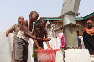 The Water Project: Lungi, Yongoroo, #7 Kamara Taylor Street -  Kids Splash Water From The Well