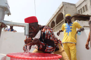 The Water Project: Lungi, Yongoroo, #7 Kamara Taylor Street -  Ward Councilor Abubakarr Koroma Drinks From The Well