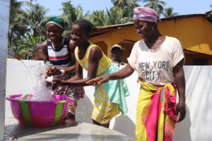 The Water Project: Polloth Village, Kroo Town Area -  Children Splash Water At The Well