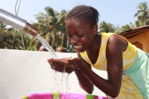 The Water Project: Polloth Village, Kroo Town Area -  Girl Drinks From The Well