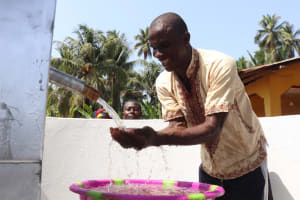 The Water Project: Polloth Village, Kroo Town Area -  Headman Celebrates The Well