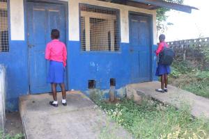 The Water Project: Masoila Roman Catholic Primary School -  Students Waiting To Use Latrine