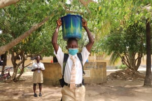 The Water Project: Lungi, Masoila, St. Joseph Junior Secondary School -  Student Carrying Water