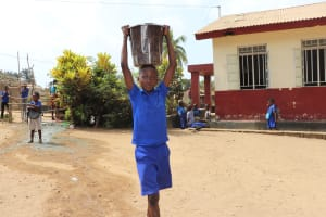 The Water Project: Shepherd Foundation, New Apostolic Church and Primary School -  Student Carrying Water