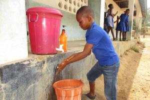 The Water Project: Shepherd Foundation, New Apostolic Church and Primary School -  Student Demonstrating Handwashing
