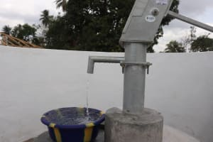 The Water Project: Kamasondo, Robombeh Village, Next to Mosque -  Clean Water Flowing
