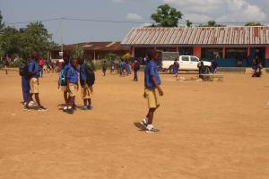 The Water Project: Masoila Roman Catholic Primary School -  Students Outside Classroom