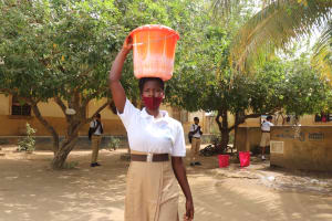 The Water Project: St. Joseph Senior Secondary School -  Student Carrying Water