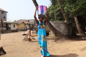 The Water Project: Lungi, Targrin, #11 King Street -  Young Girl Carrying Water