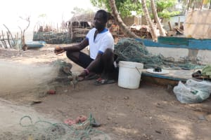 The Water Project: Lungi, Targrin, #11 King Street -  Young Man Preparing Fishing Net
