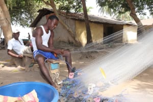 The Water Project: Lungi, Targrin, #11 King Street -  Preparing Fishing Net