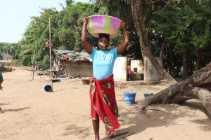 The Water Project: Lungi, Targrin, #11 King Street -  Woman Carrying Water