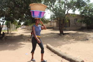 The Water Project: Lungi, Targrin, #11 King Street -  Young Girl Carrying Goods To The Market