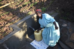 The Water Project: Khaunga A Community, Murutu Spring -  Smiling While Fetching Water