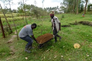 The Water Project: Muyundi Community, Magana Spring -  Community Members Moving Sand