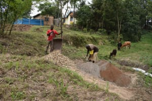 The Water Project: Bukhaywa Community, Violet Inganji Spring -  Community Members Help Deliver Materials To The Work Site