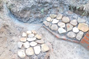 The Water Project: Musango Community, Wambani Spring -  Stone Pitching