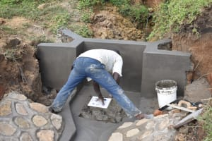 The Water Project: Ikoli Community, Odongo Spring -  Placing The Tiles