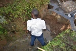 The Water Project: Ikoli Community, Odongo Spring -  Reinforcing The Headwall And Wing Walls With Clay
