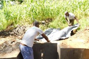 The Water Project: Musango Community, Wambani Spring -  Fitting The Plastic Tarp