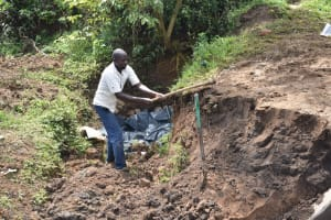 The Water Project: Ikoli Community, Odongo Spring -  Backfilling With Soil