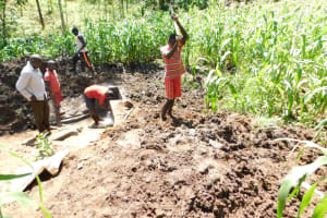 The Water Project: Musango Community, Wambani Spring -  Backfilling With Soil
