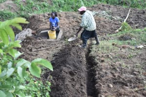 The Water Project: Ikoli Community, Odongo Spring -  Digging Diversion Channels