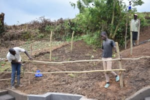 The Water Project: Ikoli Community, Odongo Spring -  Setting Up The Fence