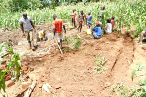 The Water Project: Musango Community, Wambani Spring -  Inspecting Work On A Diversion Channel On Side Of Spring