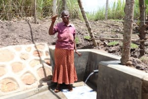 The Water Project: Malekha Central Community, Misiko Spring -  Thumbs Up At The Spring