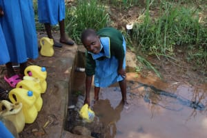 The Water Project: Bukhakunga Primary School -  Celine Fetching Water At The Spring