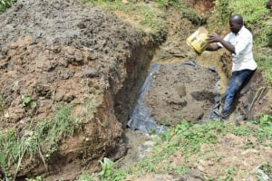 The Water Project: Ikoli Community, Odongo Spring -  Pouring Concrete Foundation