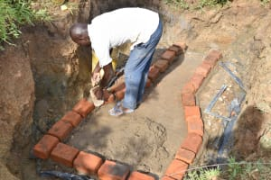 The Water Project: Ikoli Community, Odongo Spring -  Bricklaying Begins