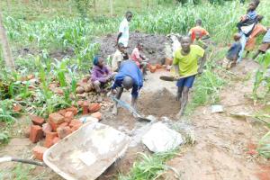 The Water Project: Musango Community, Wambani Spring -  Mixing Construction Materials