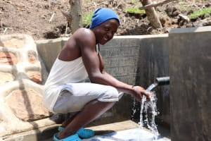 The Water Project: Malekha Central Community, Misiko Spring -  Enjoying Water