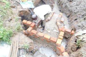The Water Project: Musango Community, Wambani Spring -  Raising The Walls