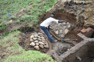 The Water Project: Ikoli Community, Odongo Spring -  Stone Pitching