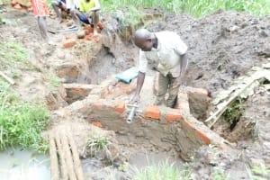The Water Project: Musango Community, Wambani Spring -  Setting The Pipe