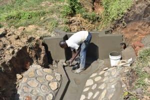 The Water Project: Ikoli Community, Odongo Spring -  Plastering