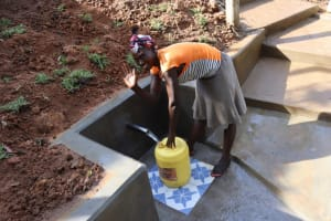 The Water Project: Malekha West Community, Soita Spring -  Collecting Water