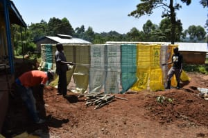 The Water Project: Lwombei Primary School -  Sacks For Cement Plaster
