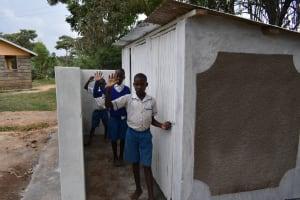 The Water Project: Lwombei Primary School -  Boys Latrine